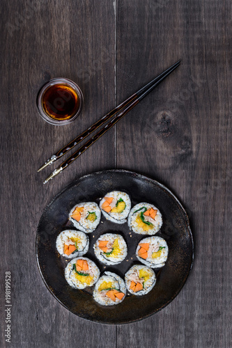 Fotobehang Sushi bar Hosomaki sushi on wooden table