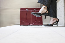 Businesswoman's Feet In High H...