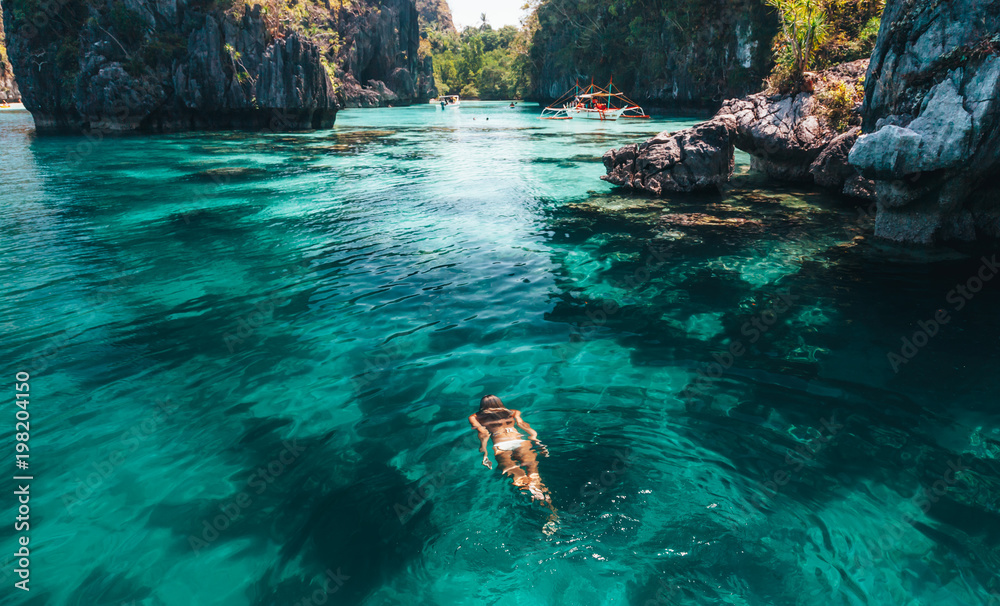 Fototapety, obrazy: Woman swimming in clear sea water in Asia