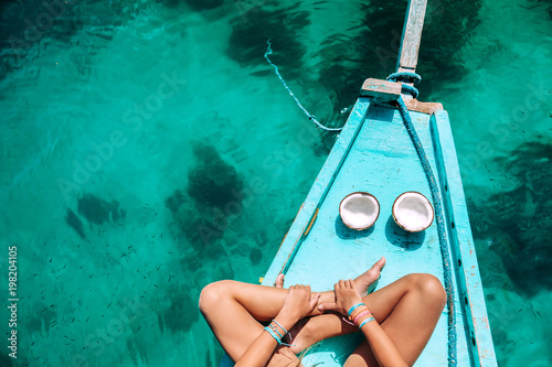 Spoed Foto op Canvas Asia land Girl eating coconut on the boat in Asia