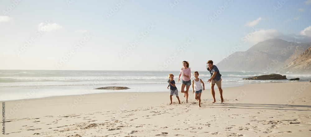 Fototapety, obrazy: Parents Running Along Beach With Children On Summer Vacation