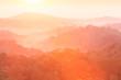 Golden sunrise shines onto the mountain range.