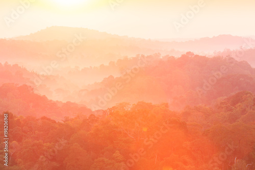 Canvas Prints Coral Golden sunrise shines onto the mountain range.