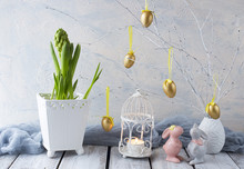 Easter Background: Hyacinth, Painted Golden Eggs And Two Easter Bunnies