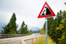 Falling Rocks Road Sign On Win...