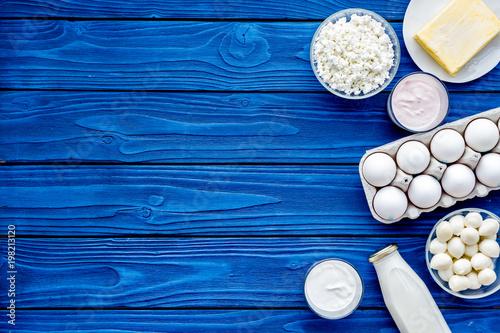 Fototapeta Dairy products from farm. Milk, cottage, cheese, yougurt on wooden top view mockup obraz na płótnie