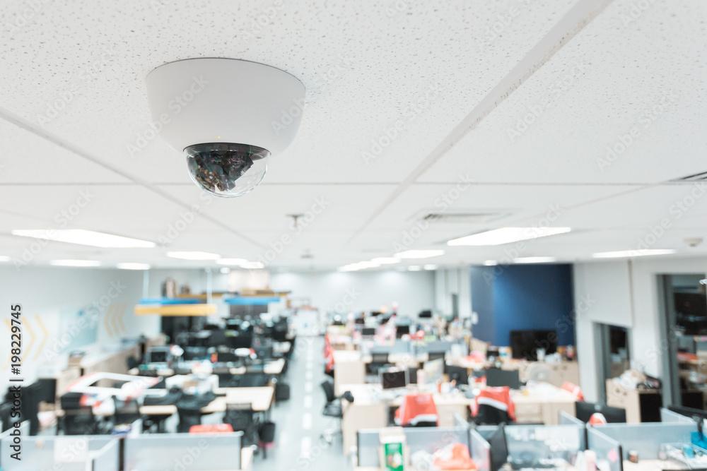 Fototapeta CCTV or surveillance operating in office building blur background.