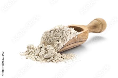 Cuadros en Lienzo  Buckwheat flour in scoop on white background