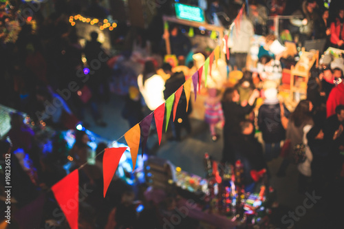 Fotografía  Christmas Market Interior with New Year decorations and multicolored flags