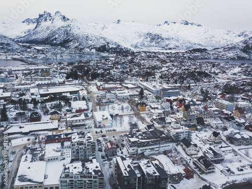 Beautiful super wide-angle winter snowy view of Svolvaer, Norway, Lofoten Islands, with skyline, mountains, Austvagoya island, Vagan municipality, Nordland, Northern Norway