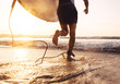 canvas print picture - Man surfer run in ocean with surfboard. Active vacation, health lifestyle and sport concept image