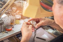 Close Up Watchmaker Repairing Mechanism Old Watch