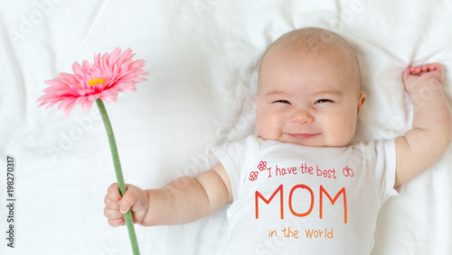 Photo  Mother's Day message with baby girl holding a flower