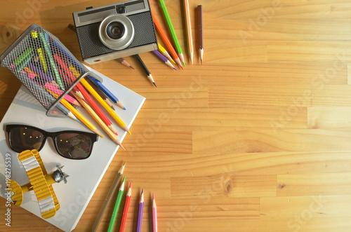 colors pencils  books  hobby on designer work table designer background concept & colors pencils  books  hobby on designer work table designer ...