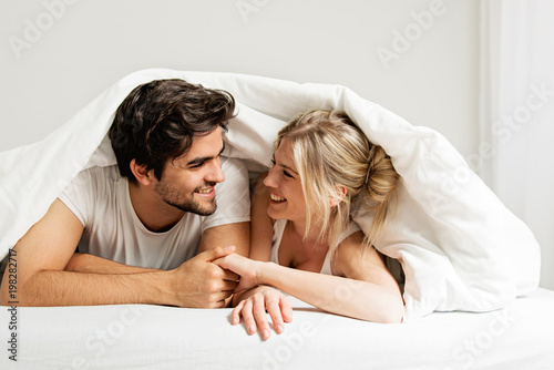 Young loving couple lying on the bed, enjoying Canvas