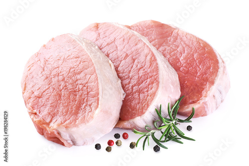 Raw sliced pork loin with pepper and rosemary isolated on white background. Fresh meat.