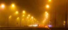 City Lights In A Foggy Night