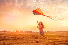 Child Running Flying Kite