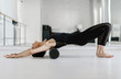 A Woman Doing Reformer Pilates Exercise