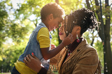 African American Single Mother In Park With Her Daughter.