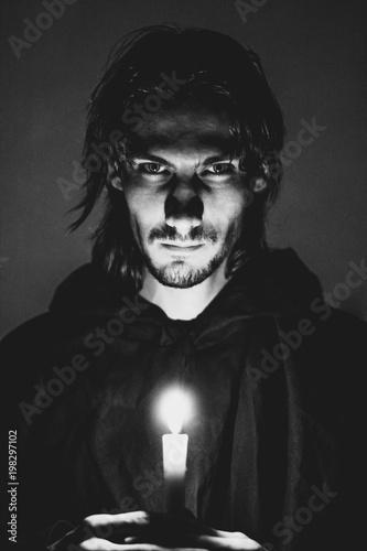 Obraz na plátne evil sorcerer with a candle