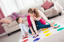 Young Mother Playing Twister W...