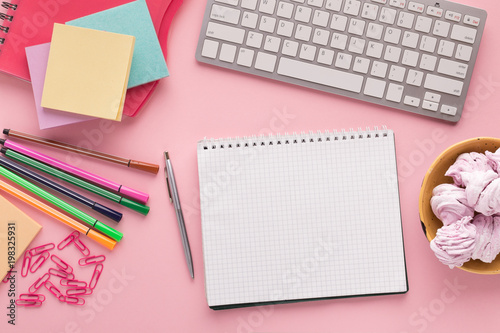 Fototapeta Spiral notepad on pink background, top view obraz na płótnie