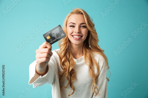 Portrait of a smiling young blonde woman in sweater Canvas Print