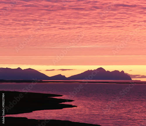 Recess Fitting Candy pink Incredibly beautiful dawn (sunset) on the shore of the Atlantic Ocean. Silhouettes of mountains and red clouds. Iceland.