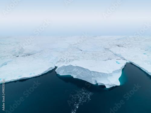 Valokuva  Arctic icebergs on arctic ocean in Greenland