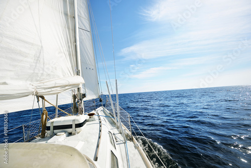 View from the bow of a sail yacht in the open sea on a bright day