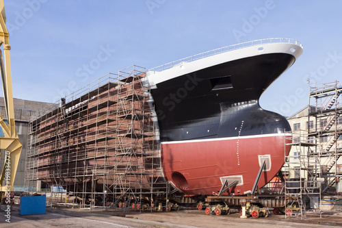 Hull of ship under construction at shipyard. Canvas Print