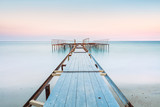 Long esposure view of a old jetty in a calm sea with gentle sky, soft colors - 198344929
