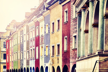 Merchant houses facades in the Poznan Old Market Square, color toned picture, Poland.