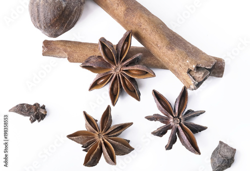 top view on anise, cinnamon and nutmeg on white background Wallpaper Mural