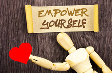 Text Sign Showing Empower Yourself. Conceptual Photo Positive Motivation Advice For Personal Development Written On Sticky Note Love Heart Holding By Sculpture On The Wooden Background.
