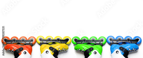 Long banner colored roller skates on isolated white background