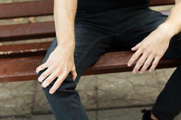 Man holding hands sore knee