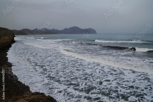 Fotobehang Grijs Landscape with stormy sea in cloudy weather