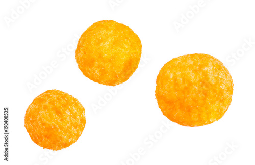 Fotografía  Cheese balls snack isolated over white background, include clipping path