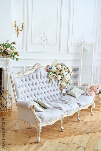 Soft Sofa With Gray Fabric Upholstery, Pillows And Flowers On It, Copy  Space.