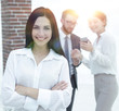 successful young business woman against the background of collea