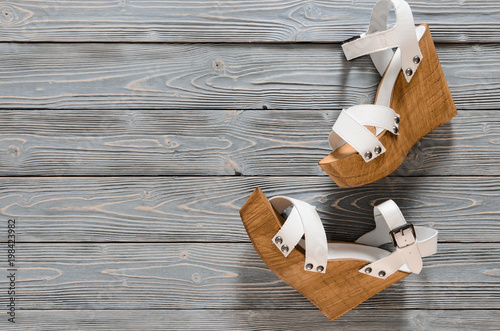 Slika na platnu Womens shoes (crisscross wood platform wedges) on grey wooden background