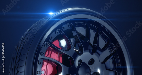 Fotografía  Close up sports car tire with lens flare