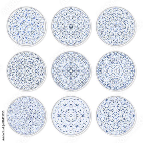 Fotografie, Obraz  Set of decorative plates with a circular arabic blue pattern, top view
