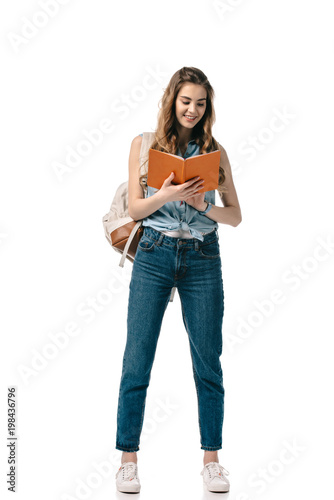 Smiling Beautiful Student Reading Book Isolated On White