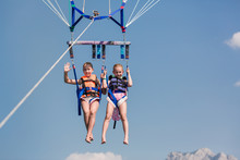 Two Happy Girls Parasailing