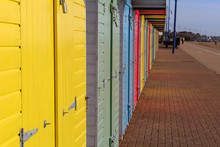 Brightly Coloured Beach Huts On The Seafront
