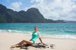 Beautiful woman is relaxing on idyllic beach, El Nido bay, Palawan island, Philippines