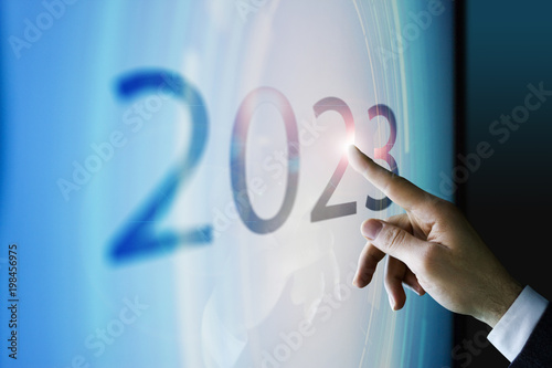 Poster  Businessman touching the screen about 2023